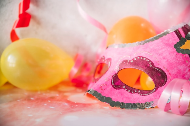 Art mask with balloons and ribbons Free Photo