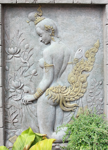 Art stucco from thai mythology on wall of temple. Premium Photo