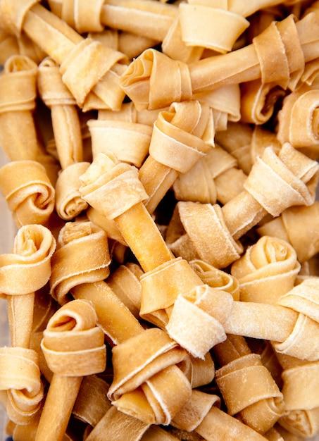 Artificial dog bones with two knots Premium Photo