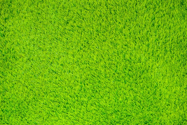 Artificial grass surface for the background. Premium Photo