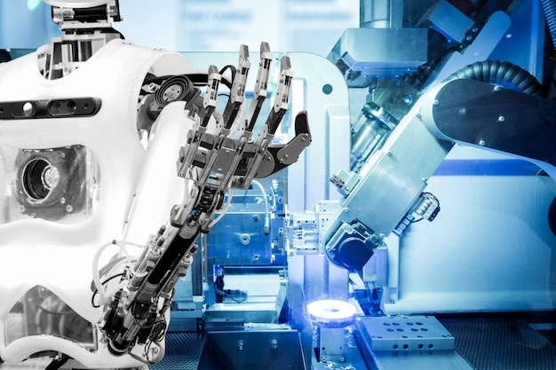 Artificial intelligence on industrial robotics in blue tone color background Premium Photo