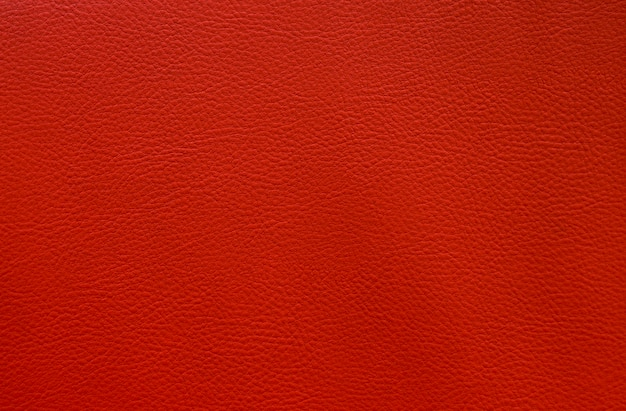 Artificial red leather close up texture background small pattern Premium Photo