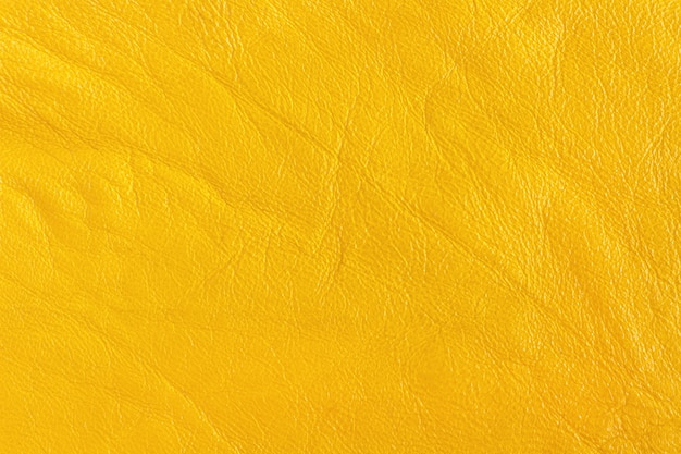 Artificial skin in yellow color. background, texture ...