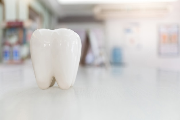 Artificial teeth model on wood table with blur background Premium Photo