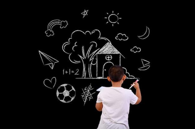 Artist boy drawing on a blackboard Free Photo