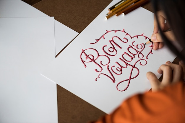 An artist creating hand lettering artwork Premium Photo