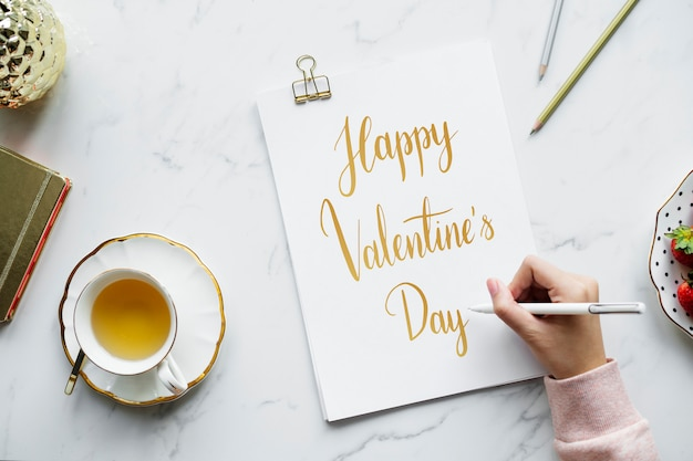 Artist drawing a valentines card Free Photo