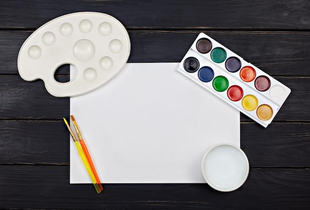 Artist workspace with watercolor palette Premium Photo