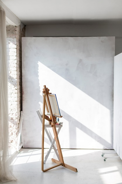 Artistic easel and canvas in studio Free Photo