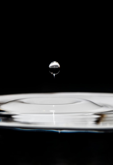 Artistic floating water drop black and white effect Free Photo