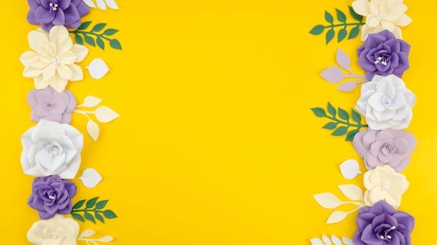 노란색 배경으로 예술적인 꽃 프레임 무료 사진