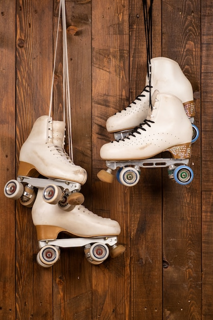 Artistic roller skates on a wood background Premium Photo