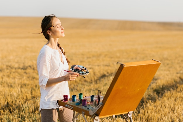 Artistic young woman feeling the air Free Photo