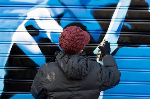 Artists painting a graffito Premium Photo