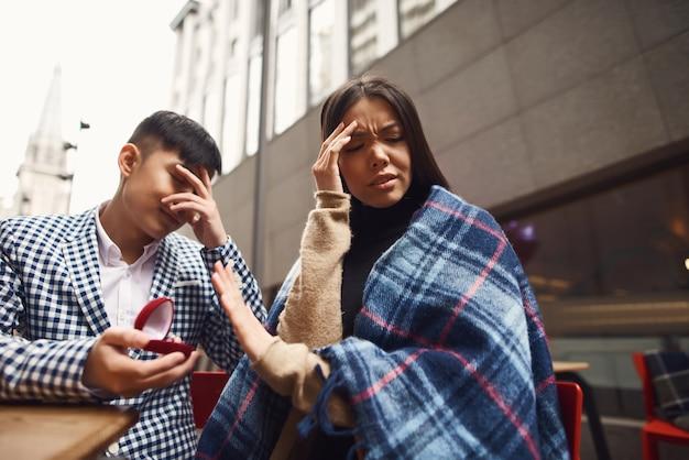 Ashamed sad boy girl rejected offer of marriage. Premium Photo