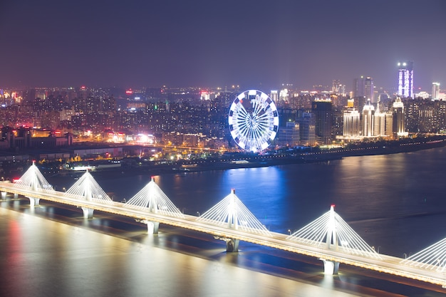 Asia's largest across the rivers in shanghai landmarks a spiral bridge at night Premium Photo