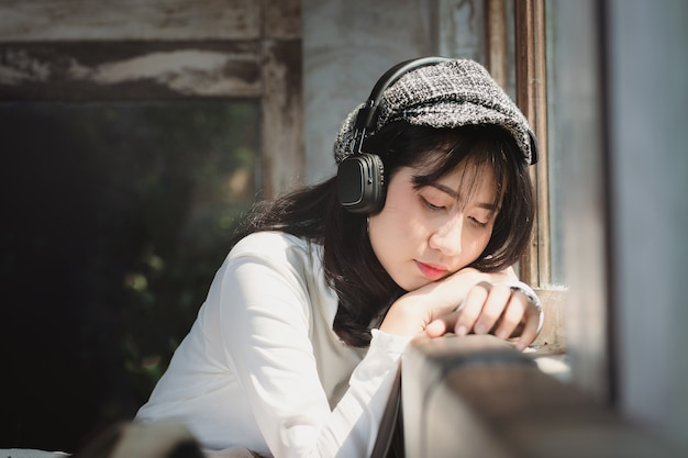 Asia woman listening to music with lonely. Premium Photo