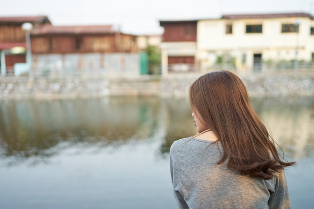 Asia woman sitting at river side Premium Photo