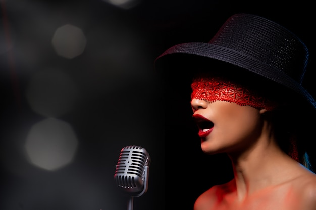 Asian adult woman sing a song loudly power sound Premium Photo