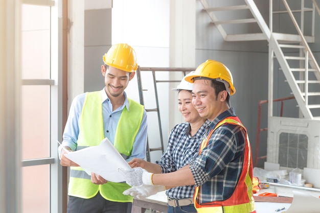 Asian architect engineers talking and reading plan in paper Premium Photo