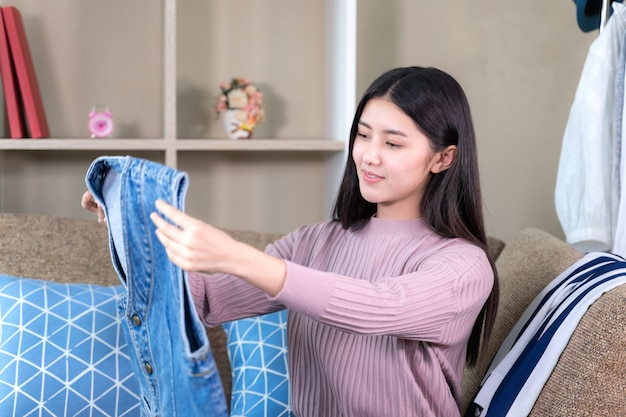 Asian attractive woman looking to new clothes with smiling Free Photo