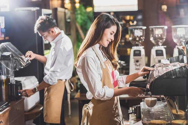 Free Photo   Low angle of male barista packing coffee for
