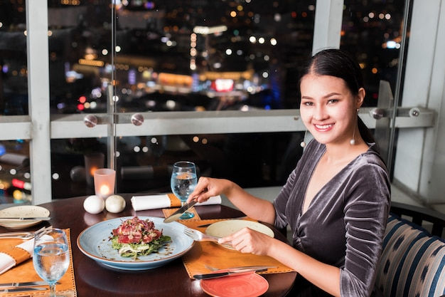 Asian beautiful woman have dinner in luxury roof top restaurant Premium Photo