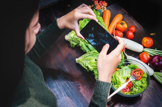 Asian beautiful young girl eating salad vegetable Premium Photo