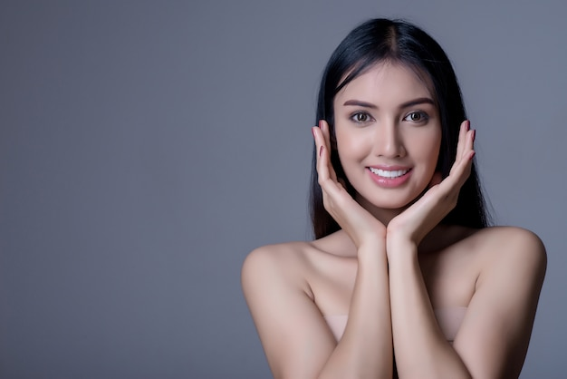 Asian beautiful young woman with clean fresh skin touch own face,beauty and spa . Premium Photo