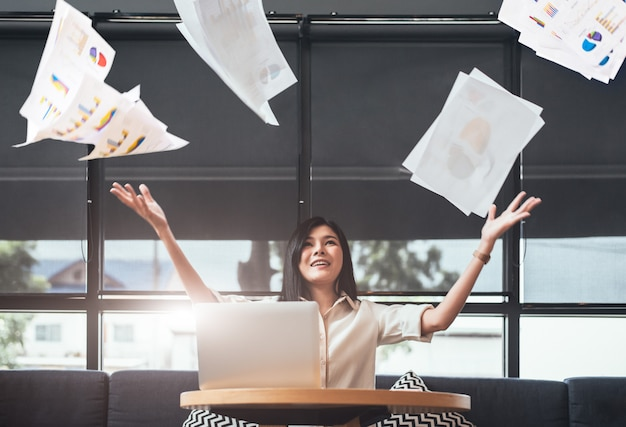 Asian beauty businesswoman throwing paperwork into the air. successful and achievement Premium Photo