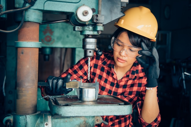 Asian beuatiful woman working with machine in the factory engineer and working woman concept or woman day Premium Photo