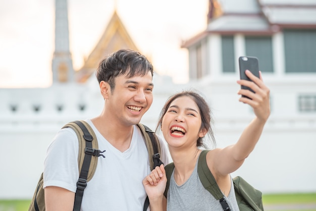 Asian blogger couple travel in bangkok, thailand Free Photo