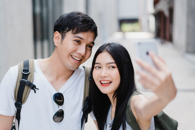 Asian blogger couple travel in beijing, china Free Photo