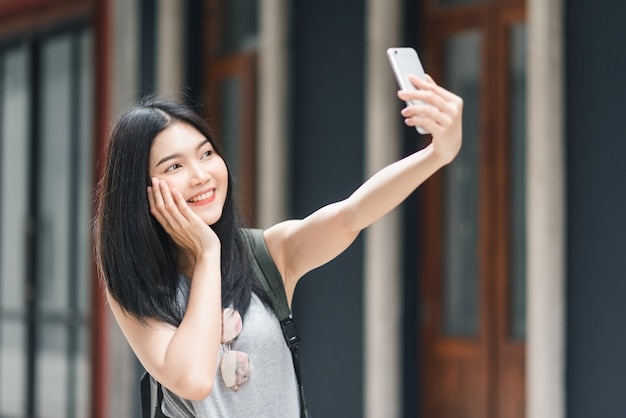 Asian blogger woman travel in beijing, china Free Photo