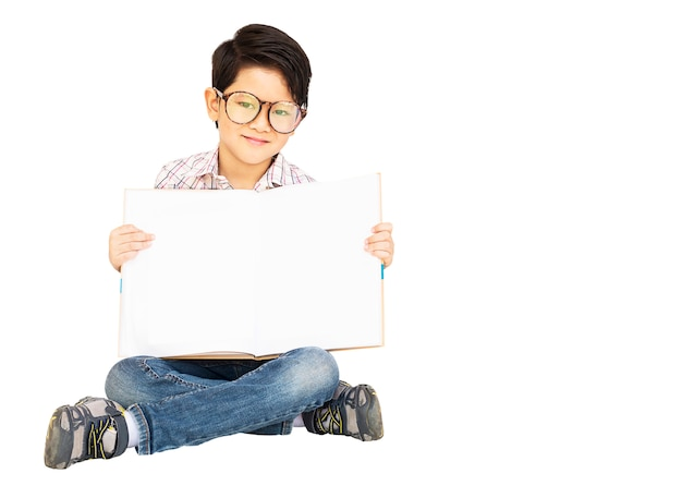 Asian boy is happily showing empty book Free Photo