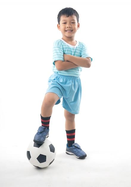 Asian boy playing football isolated Premium Photo