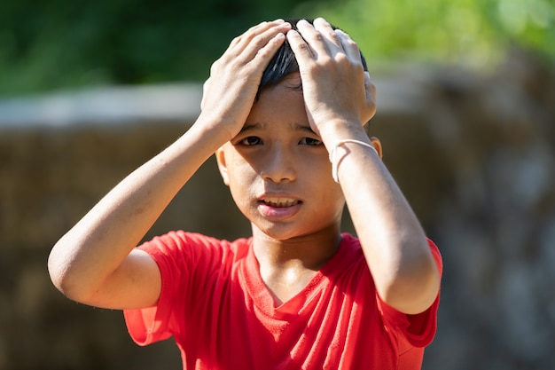 Asian boy showing sad expression Premium Photo