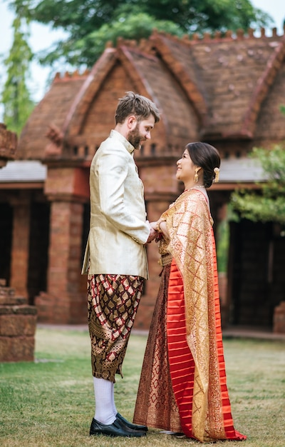 Asian bride and caucasian groom have romantic time with thailand dress Free Photo