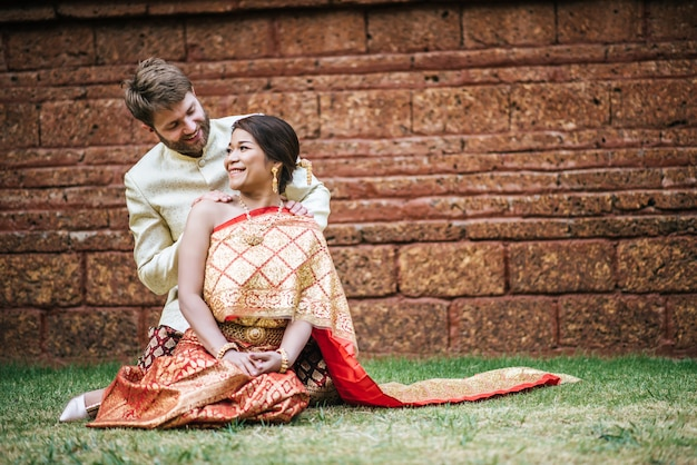 Asian bride and caucasian groom have romantic time with
