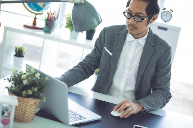 Asian business man wearing eyeglass in office. Premium Photo