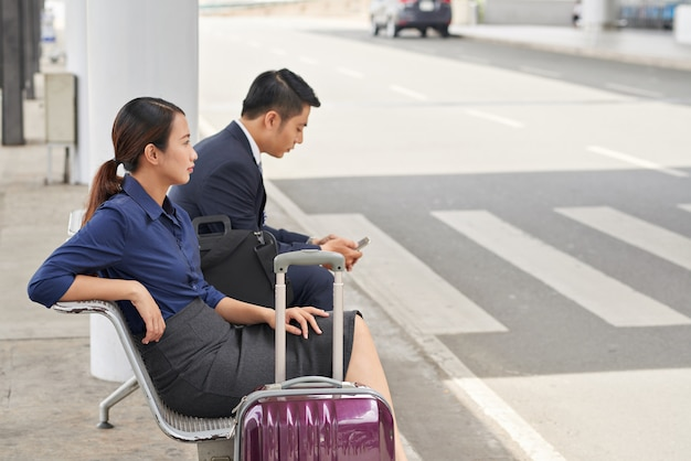 Asian business people waiting for taxi in airport Free Photo