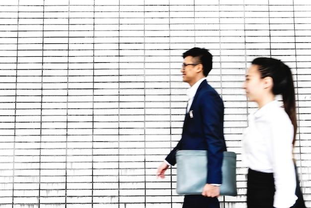 Asian business people walking Free Photo