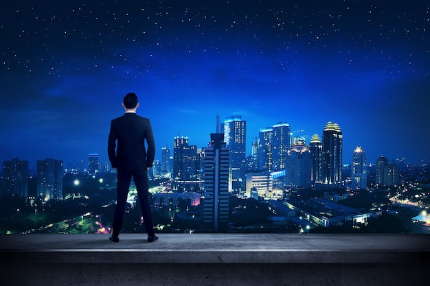 Asian business person standing on the rooftop Premium Photo