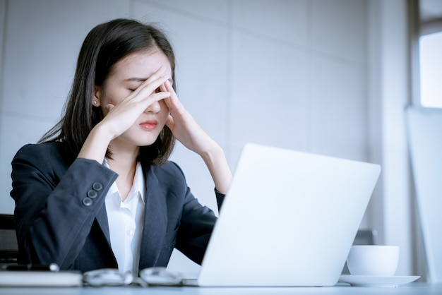 Premium Photo | Asian business woman stress because work mistake to be risk  for fired