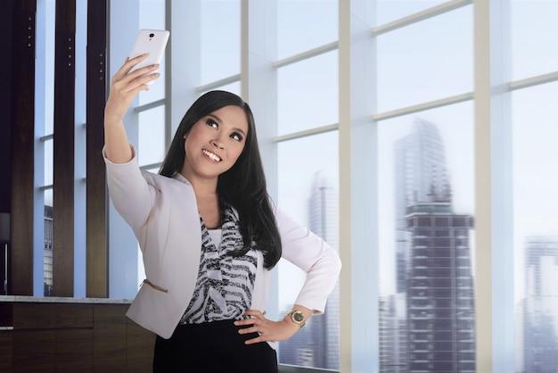 Asian business woman take selfie Premium Photo