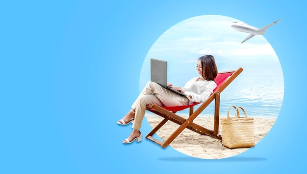 Asian business woman working with laptop sitting in the beach chair Premium Photo