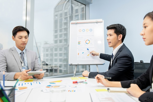 Asian businessman presenting business plan charts at the meeting Premium Photo