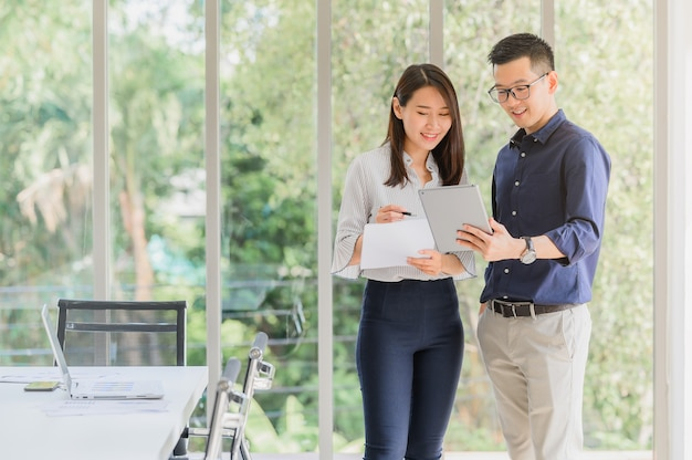 Asian businessman and woman discussing new business project Premium Photo