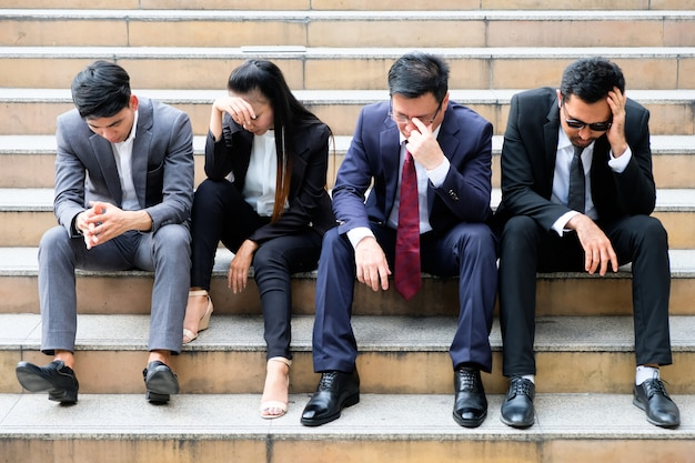 Asian businessmen sitting dismal because of unemployment. Premium Photo