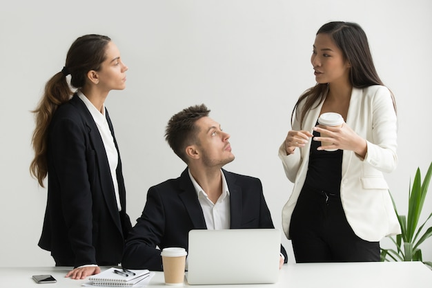 Asian businesswoman explaining new business approach to millennial executive team Free Photo